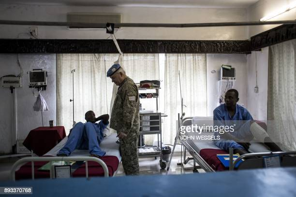 TOPSHOT United Nations military official greets and checks up on wounded Tanzanian peacekeepers on December 15 2017 in Goma Tanzania called on...