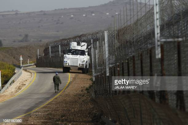 A United Nations military vehicle is pictured during the reopening of the only crossing point between Syria and Israeliannexed Golan heights near...
