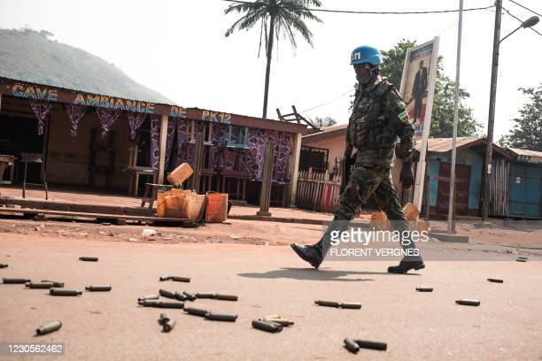 United Nations Multidimensional Integrated Stabilization Mission in the Central African Republic soldier patrols in PK12, in front of a bar where it...