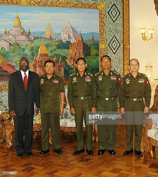 United Nations official Ibrahim Gambari poses with Myanmar's Senior General Than Shwe ViceSenior General Maung Aye General Thura Shwe Mann and Acting...