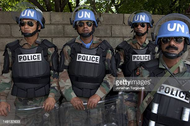 United Nations Peace Keeping Forces from India stand guard outside the Karibe hotel where JeanClaude Duvalier the former Haitian leader known as...