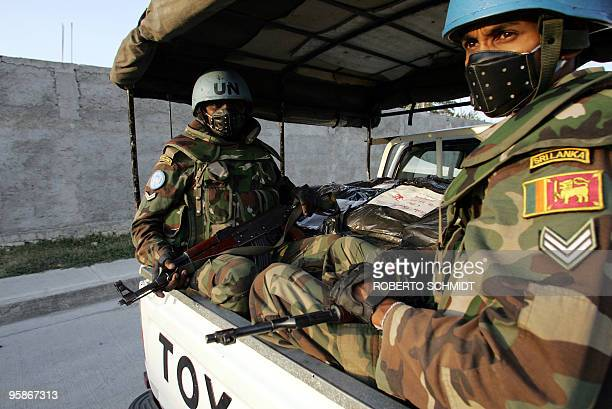 United Nations peacekeepers from Sri Lanka guard bags containing electoral material as they ride their vehicle in Port-Au-Prince 03 February 2006....