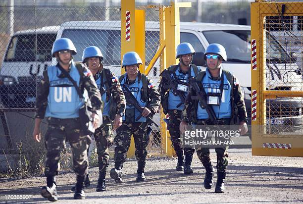 United Nations peacekeepers from the Philippines cross the Israeli army crossing of Quneitra between Syria to the Israeli annexed Golan Heights on...
