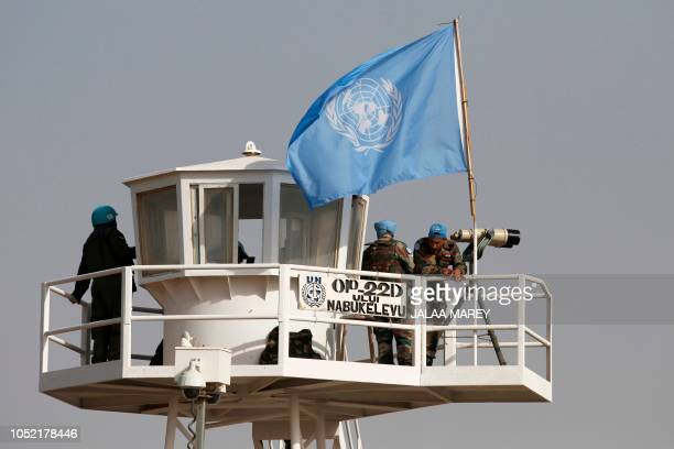 United Nations peacekeepers observe the Quneitra border crossing with Syria in the Israeli annexedGolan Heights during its reopening on October 15...