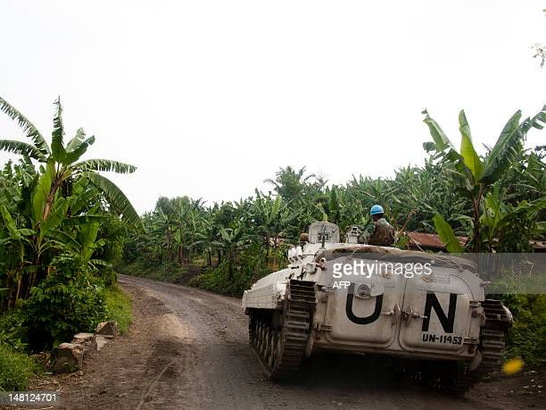 United Nations peacekeepers stand deployed with an armoured personnel carrier on the road between Bunagana and Rutshuru on July 10 2012 Since...