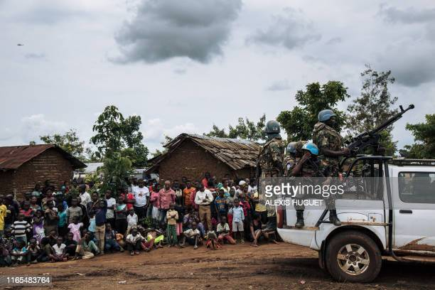 United Nations peacekeepers wait for the arrival of the UN secretary-general at an Ebola treatment centre in Mangina, North Kivu province, on...