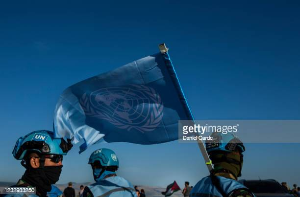 United Nations peacekeeping force in Lebanon soldiers monitor a demonstration to show solidarity with Palestinians as near the Lebanon-Israel border...