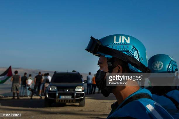 United Nations peacekeeping force in Lebanon soldiers monitor as people hold demonstration to show solidarity with Palestinians near the...