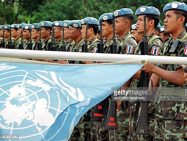 United Nations Peacekeeping Forces from Thailand hold their guns up during a ceremony to mark the handover responsibility between UN peacekeeping...