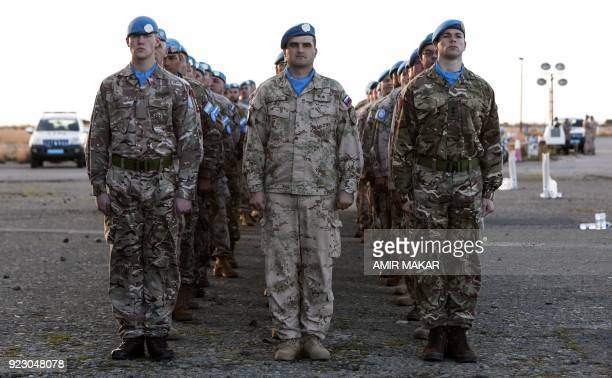 United Nations peacekeeping officers of the UN Peacekeeping Force in Cyprus line up before a Peace Medals ceremony at the old Nicosia airport in the...