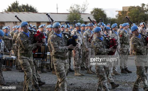 United Nations peacekeeping officers of the UN Peacekeeping Force in Cyprus march with the bagpipes at the start of a Peace Medals ceremony at the...