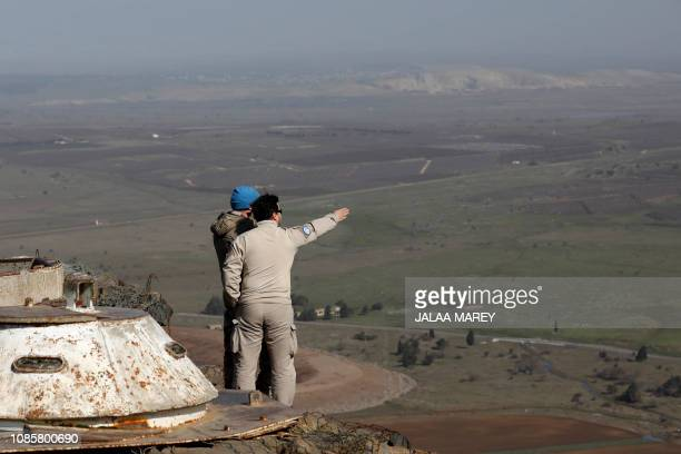 United Nations personnel stand at a lookout point as they monitor the IsraelSyria border in the Israeliannexed Golan Heights on January 21 2019 Prime...