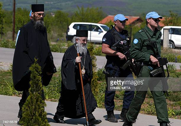 United Nations police officers secure Archbishop Artemije after his meeting with UN ambassadors in the ethnically mixed village of Brestovik 28 April...