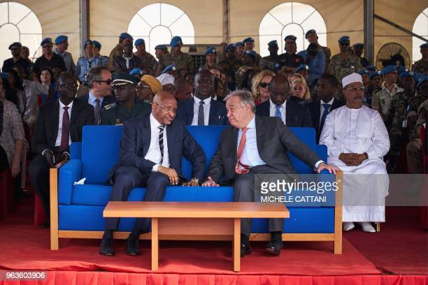 United Nations Secretary General Antonio Guterres chats with Malian Prime Minister Soumeylou Boubeye Maiga during the ceremony of Peacekeepers' Day...