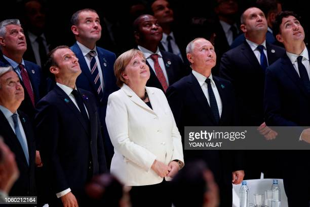United Nations Secretary General Antonio Guterres French President Emmanuel Macron German Chancellor Angela Merkel Russian President Vladimir Putin...