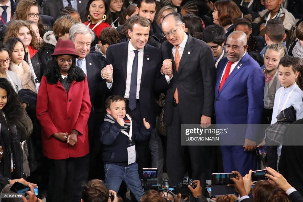 United Nations (UN) Secretary General Antonio Guterres (L), French President Emmanuel Macron (2nd L), World Bank President Jim Yong Kim (2nd R) and President of the Comores Azali Assoumani (R) pose at the end of a session of the One Planet Summit on December 12, 2017, at La Seine Musicale venue on l'ile Seguin in Boulogne-Billancourt, southwest of Paris. ââ¬â¹The French President hosts 50 world leaders for the 'One Planet Summit', hoping to jump-start the transition to a greener economy two years after the historic Paris agreement to limit climate change. /