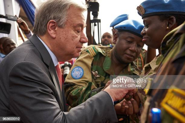 United Nations Secretary General Antonio Guterres gives a medal to a UN soldier during the ceremony of Peacekeepers' Day at the operating base of...