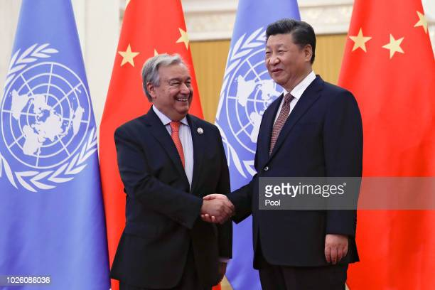 United Nations Secretary General Antonio Guterres, left, shakes hands with Chinese President Xi Jinping before proceed to their bilateral meeting at...