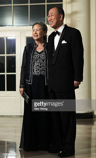 United Nations Secretary General Ban Kimoon and his wife Ban Soontaek arrive at a state dinner at the White House October 13 2011 in Washington DC...