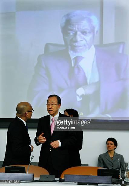 United Nations Secretary General Ban Ki-moon talks with a delegate as the image of UN-Arab League envoy Kofi Annan is seen on a screen before the...