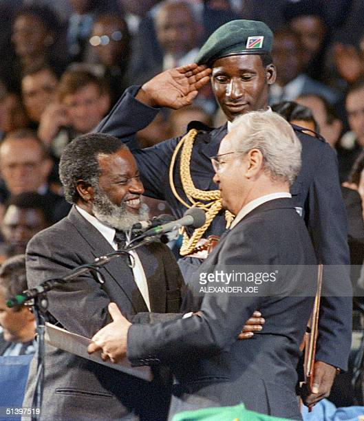 United Nations Secretary General Javiez Perez de Cuellar congratulates the new Namibian President Sam Nujoma 21 March 1990 in Windhoek at the...