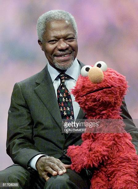 United Nations Secretary General Kofi Annan poses with the Sesame Street character Elmo after a taping of the show 06 December in New York During the...