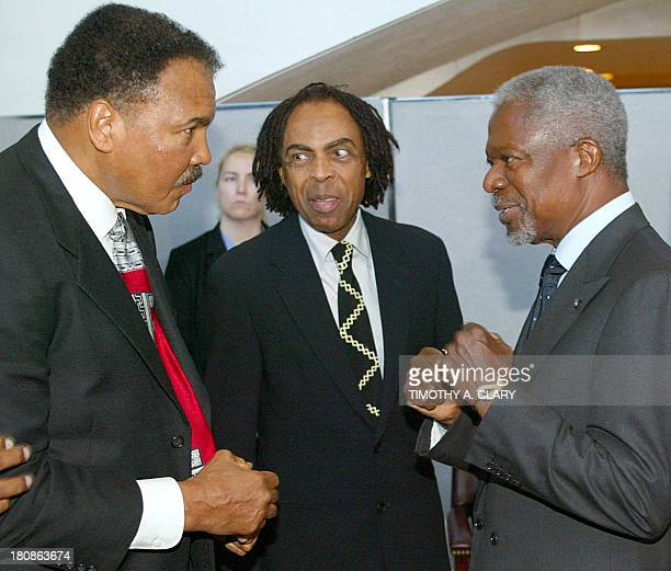 United Nations Secretary General Kofi Annan pretends to box with former heavyweight champion Muhammad Ali while Brazilian Culture Minister Gilberto...