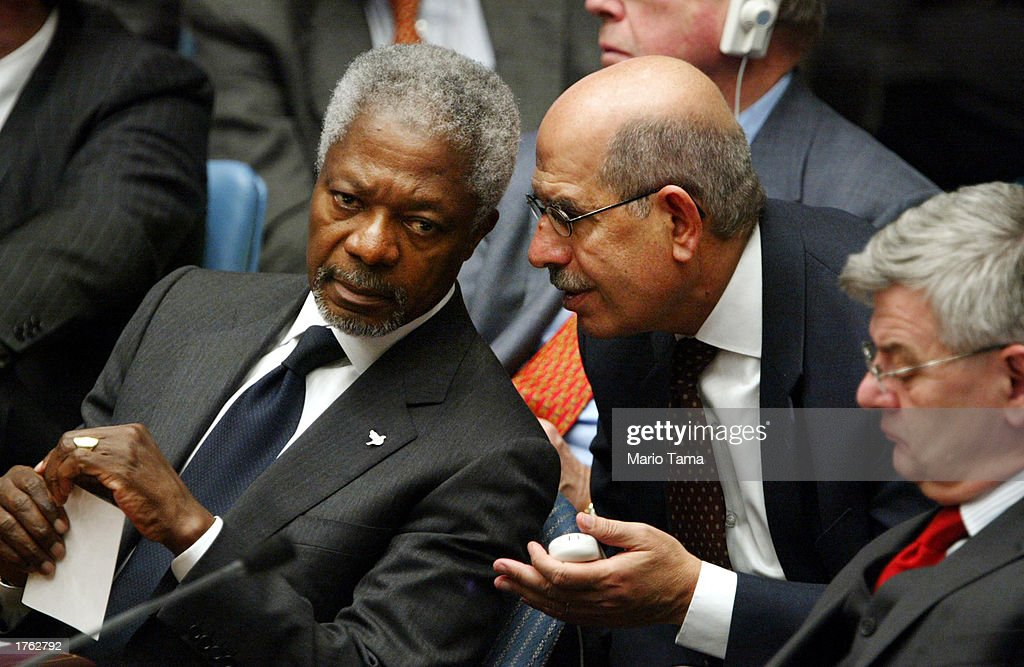 United Nations Secretary General Kofi Annan (L) speaks with International Atomic Energy Agency (IAEA) head Mohamed ElBaradei (C) next to German Foreign Minister Joschka Fischer after U.S. Secretary of State Colin Powell's address to the UN Security Council February 5, 2003 in New York City. Powell made a presentation attempting to convince the world that Iraq is deliberately hiding weapons of mass destruction.