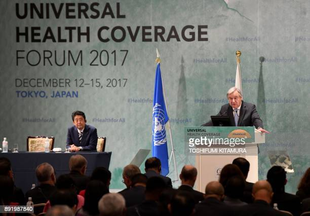 United Nations SecretaryGeneral Antonio Guterres delivers his speech while Japanese Prime Minister Shinzo Abe listens to during the Universal Health...
