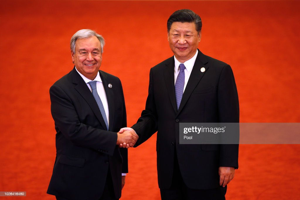United Nations Secretary-General Antonio Guterres, left, shakes hands with Chinese President Xi Jinping as they pose for photographers during the Forum on China-Africa Cooperation held at the Great Hall of the People on September 3, 2018 in Beijing, China.