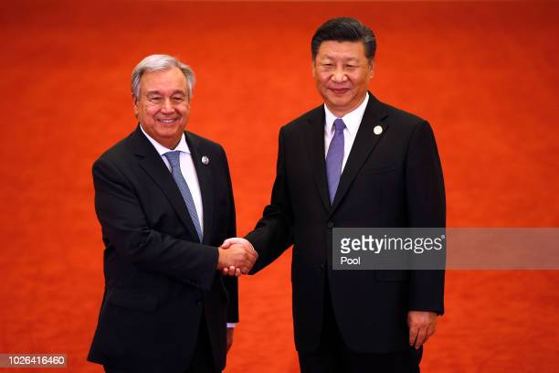 United Nations SecretaryGeneral Antonio Guterres left shakes hands with Chinese President Xi Jinping as they pose for photographers during the Forum...