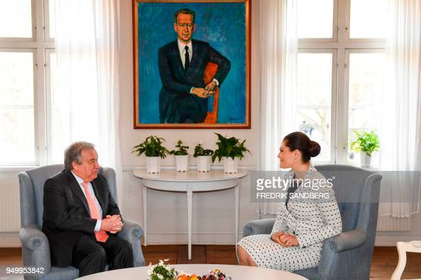 United Nations SecretaryGeneral Antonio Guterres meets with Swedish Crown Princess Victoria at the Dag Hammarskjold Foundation in Uppsala Sweden on...