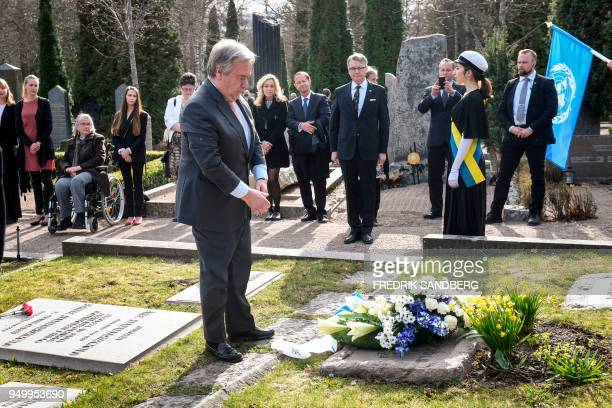 United Nations SecretaryGeneral Antonio Guterres pays his respect after laying a wreath on the grave of Dag Hammarskjold who served as UN...