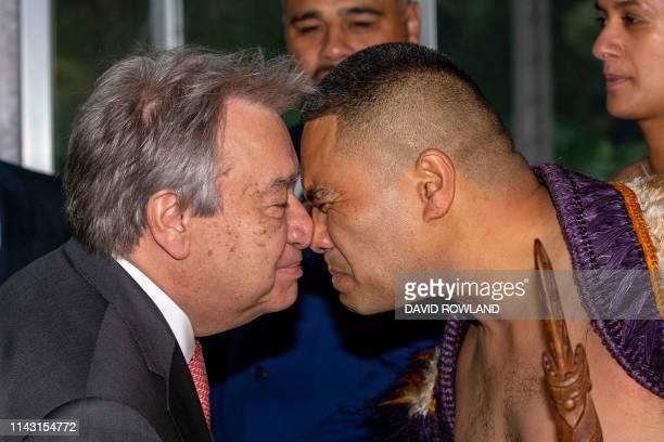United Nations SecretaryGeneral Antonio Guterres receives a hongi from a warrior during a traditional Maori welcome during his visit to Government...