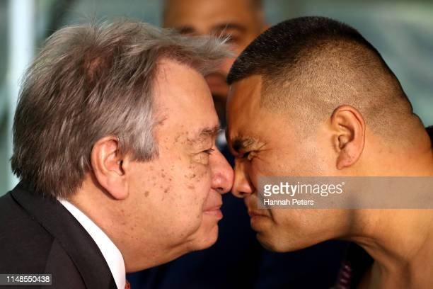 United Nations SecretaryGeneral Antonio Guterres receives a hongi from a Maori warrior at Government House on May 12 2019 in Auckland New Zealand The...