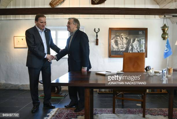 United Nations SecretaryGeneral Antonio Guterres shakes hands with Sweden's Prime Minister Stefan Lofven after signing the guest book during the...