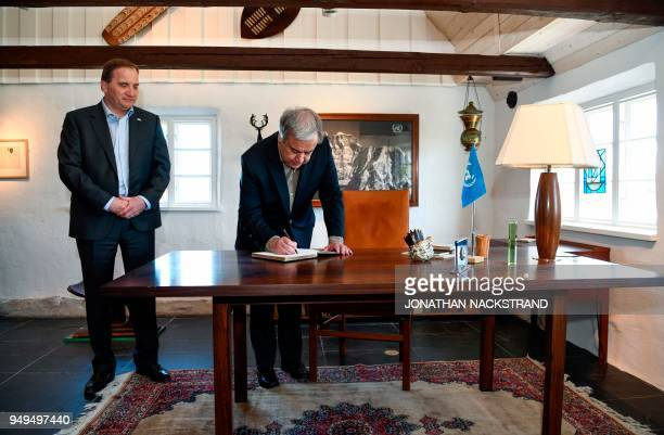 United Nations SecretaryGeneral Antonio Guterres signs the guest book as Sweden's Prime Minister Stefan Lofven look on during the annual informal...