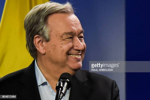 United Nations SecretaryGeneral Antonio Guterres smiles next to Colombian President Juan Manuel Santos during a press conference at the Narino...