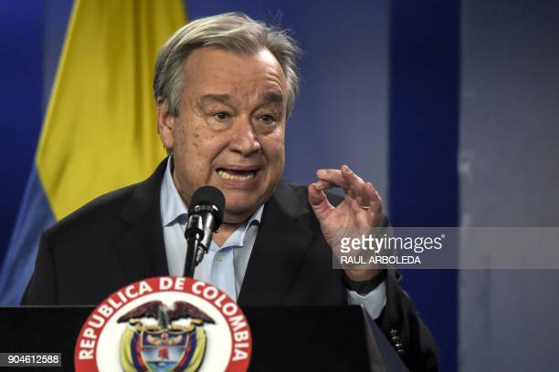 United Nations SecretaryGeneral Antonio Guterres speaks next to Colombian President Juan Manuel Santos during a press conference at the Narino...