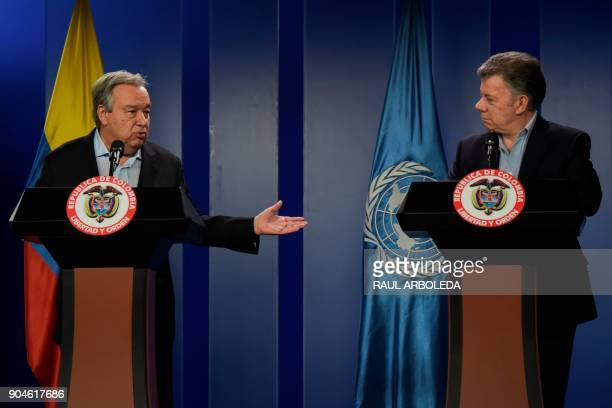 United Nations SecretaryGeneral Antonio Guterres speaks to journalists next to Colombian President Juan Manuel Santos during a press conference at...