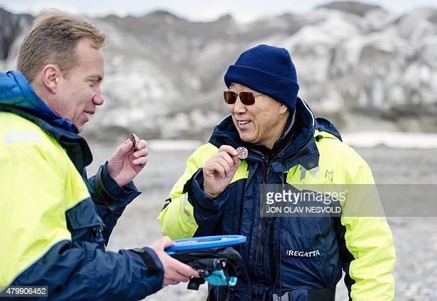 United Nations SecretaryGeneral Ban Kimoon and Norway's Foreign Minister Borge Brende taste salami during their visit at the Blomstrandbreen glacier...