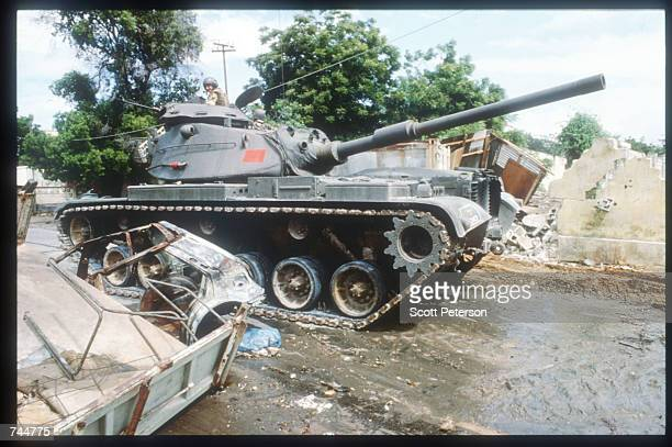 United Nations soldier drives a tank while on a peacekeeping mission June 20 1993 in Mogadishu Somalia An estimated 350000 Somalis died due to war...