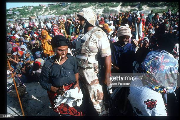United Nations soldier monitors a food distribution site June 20 1993 in Mogadishu Somalia An estimated 350000 Somalis died due to war famine and...