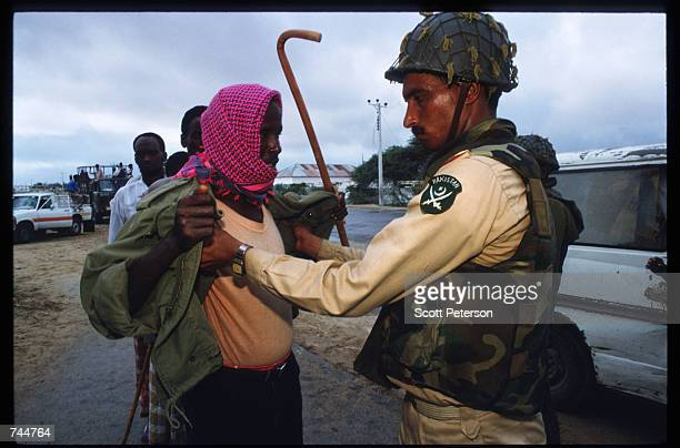 United Nations soldier searches an unidentified man while on a peacekeeping mission June 20 1993 in Mogadishu Somalia An estimated 350000 Somalis...