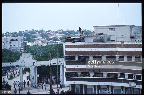 United Nations soldier stands on the roof of a building while on a peacekeeping mission June 20 1993 in Mogadishu Somalia An estimated 350000 Somalis...
