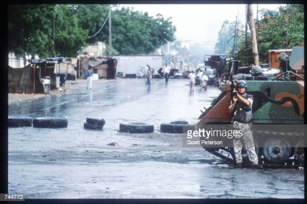 United Nations soldier stands while on a peacekeeping mission June 20, 1993 in Mogadishu, Somalia. An estimated 350,000 Somalis died due to war,...