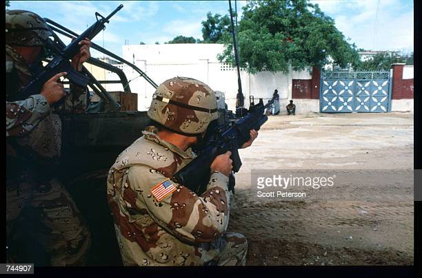 United Nations soldiers aim their guns June 6 1993 in Mogadishu Somalia UN troops seized the residence of General Mohammad Aidid a warlord...