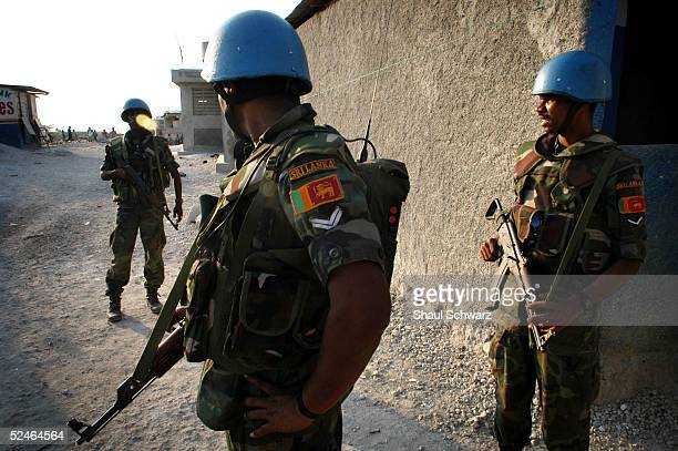 United Nations soldiers from Sri Lanka patrol the slum 'City of God' March 21 2005 in the downtown area of PortauPrince Haiti At least two members of...