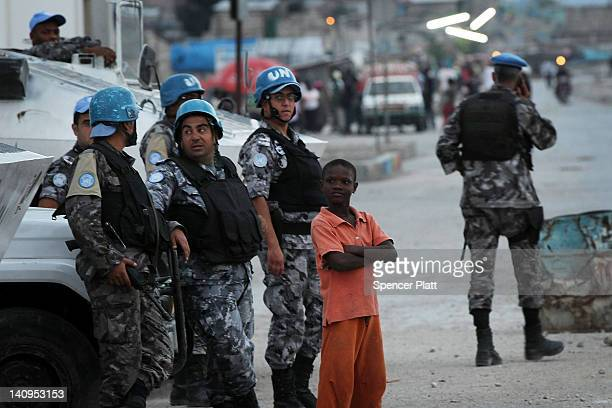 United Nations soldiers keep guard on the outskirts of Cite Soleil as tensions over the current Haitian presidents nationality spark unrest in the...