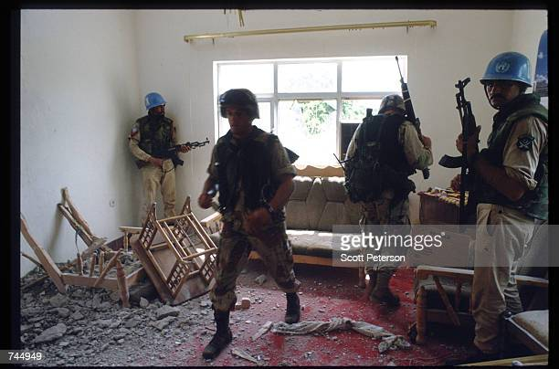 United Nations soldiers search through debris June 6 1993 in Mogadishu Somalia UN troops seized the residence of General Mohammad Aidid a warlord...